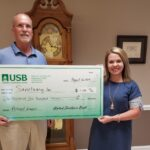 Randy Coombs, Christian County Market President Presenting Donation Check to Heather Lancaster, Executive Director of Sanctuary