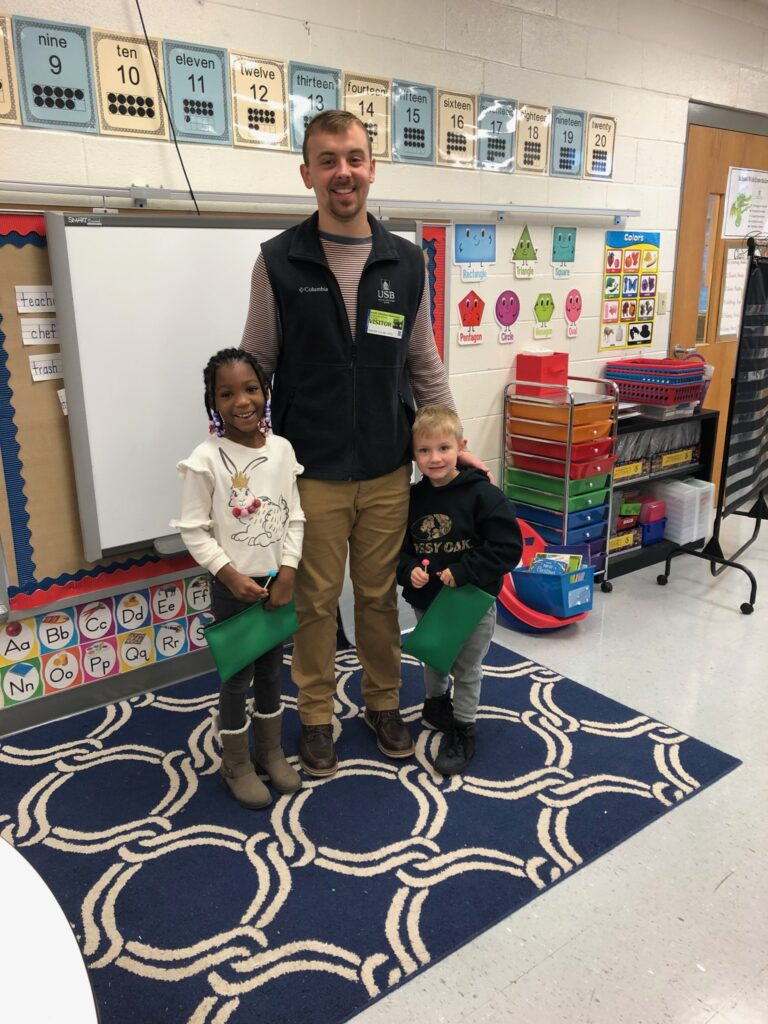 Jonathan Greene, Main branch Teller, with students from South Christian Elementary.