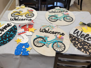 Signs painted by USB employees at our Project Fun event.